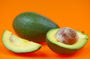 Avocado isolated on orange